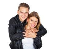 拥抱在隔绝的愉快的夫妇 库存图片
