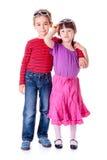 拥抱女孩的逗人喜爱的小男孩 库存照片