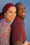 拥抱年轻人的夫妇 免版税库存图片