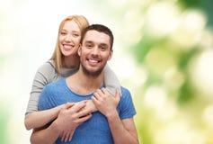 拥抱爱微笑的概念夫妇 库存照片
