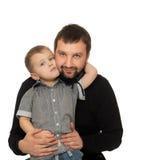 拥抱爸爸的儿子 免版税库存照片