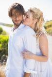 拥抱由路的有吸引力的夫妇 图库摄影