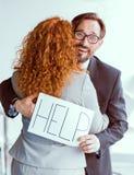 拥抱的商务伙伴,人请求与委员会的帮忙 免版税图库摄影