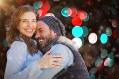 拥抱的愉快的夫妇的综合图象 库存照片