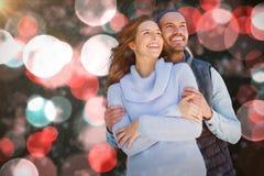 拥抱的愉快的夫妇的综合图象 免版税库存照片