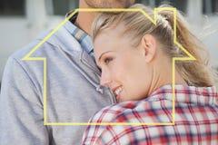 拥抱的熟悉内情的年轻夫妇的综合图象 免版税库存照片