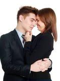 拥抱,孤立的热情的企业夫妇 库存照片