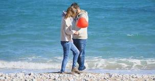 拥抱年轻人的夫妇 库存照片