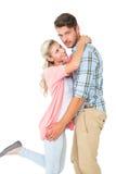 拥抱他的女朋友的英俊的人 图库摄影