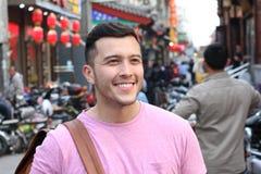 拥挤亚洲街道的逗人喜爱的人 库存照片
