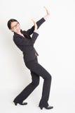 阻拦某事的亚裔女实业家  库存照片