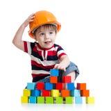 阻拦编译安全帽的男孩一点 免版税库存照片
