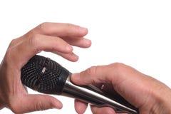 阻拦话筒的手 免版税库存照片