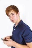 拨号与他的机动性的逗人喜爱的英俊的男孩 免版税库存照片