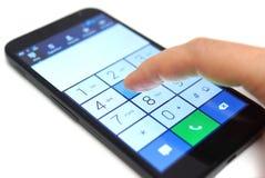 拨号在触摸屏幕智能手机 免版税库存图片