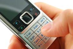 拨号移动电话的特写镜头 免版税库存照片