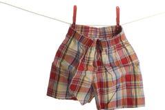 拳击手儿童洗衣店线路短裤 库存照片