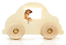 拳击手汽车木玩具的视窗 库存图片