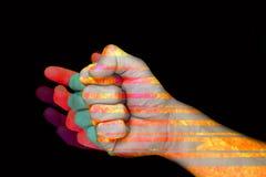 拳打力量和颜色在黑背景 库存图片