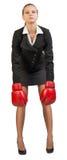拳击女实业家手套佩带 图库摄影