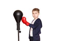 拳击手套的小男孩在白色背景 图库摄影
