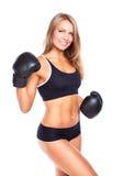 拳击手套的年轻运动妇女在白色 免版税库存照片
