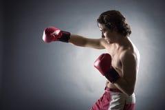 年轻拳击手战斗机 免版税库存照片
