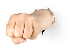 拳头拳打被撕毁的纸保险开关 免版税库存图片