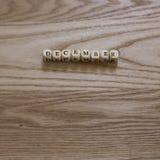 拼写在木背景的木信件12月 免版税库存照片