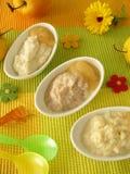 拼写的提取乳脂的饲料小米粥米 免版税库存图片