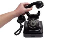 拾起老电话 免版税库存照片