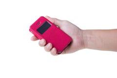 拿着一个巧妙的电话的手 免版税库存图片