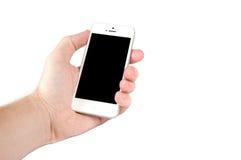 拿着一个手机的人手 库存图片