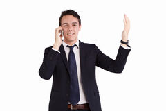 拿着一个手机的愉快的年轻白种人商人 免版税库存照片
