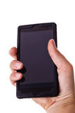 拿着一个手机 免版税图库摄影