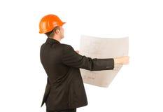 拿着一个方案的年轻建筑师 库存图片