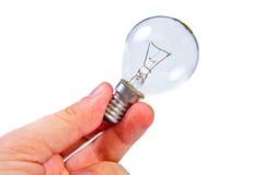 拿着一个电灯泡的手 库存图片