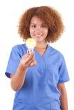 拿着一个电灯泡-黑人的非裔美国人的护士 库存图片