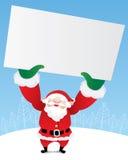 拿着一个白纸的圣诞老人 免版税库存图片