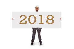 拿着一个真正地大空插件的微笑的商人- 2018年 免版税库存图片