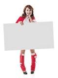 拿着一个空白的委员会的圣诞节女孩 图库摄影