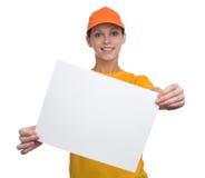 拿着一个空白的广告牌的愉快的女孩 库存照片