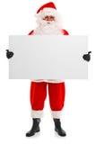 拿着一个空白符号的圣诞老人 库存照片