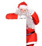 拿着一个空白符号的圣诞老人 图库摄影