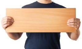 拿着一个空的木板的人现有量 免版税库存照片