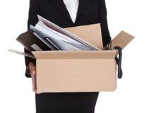 拿着一个配件箱文件的新女商人 库存照片