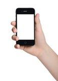 拿着一个黑电话的手 免版税库存照片