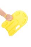 拿着一个黄色游泳浮游物的男性手 图库摄影