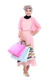 拿着一些个购物袋的美丽的年轻回教妇女 免版税库存图片