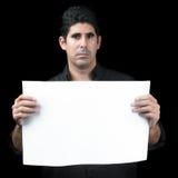 拿着一副白色横幅的严肃的西班牙人 免版税库存图片